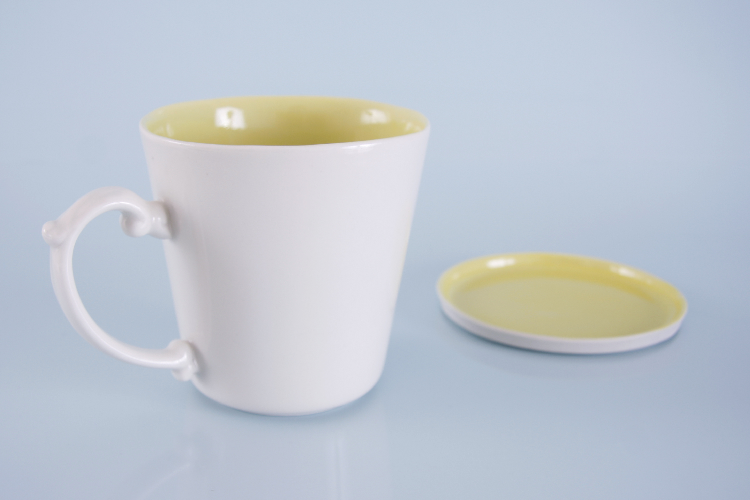 in basic white with yellow glaze inside